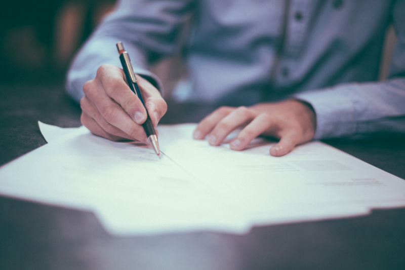 Man signing documents