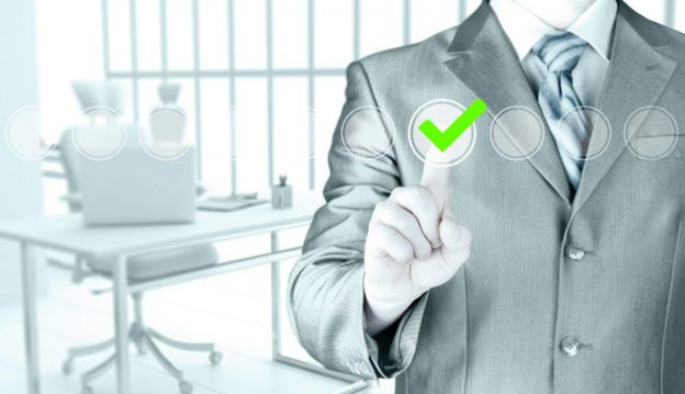 Man in suit checking a checkbox